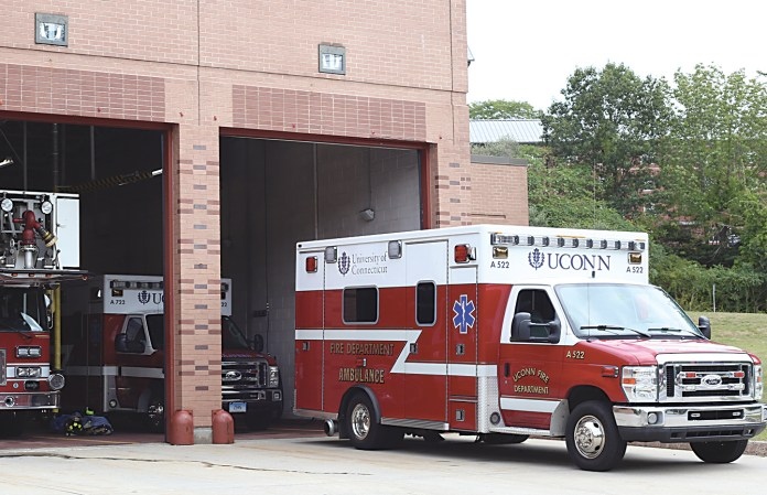 In this photo, a UConn Fire Department ambulance and other fire department vehicles are pictured at the fire department building. By adding a staff member to the 9 p.m. to 2 a.m. shift on Friday and Saturday, the department is now able to send out three ambulances. (Jackson Haigis/The Daily Campus)