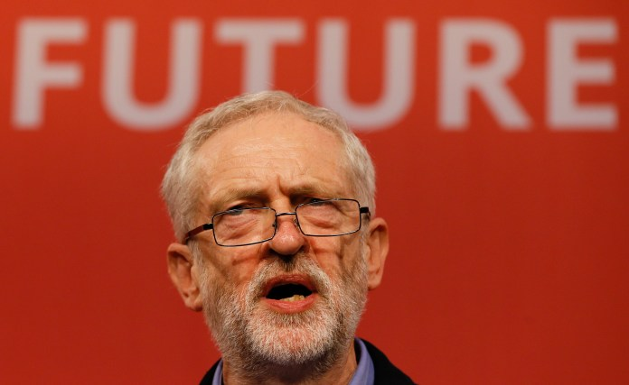 Jeremy Corbyn speaks on stage after he is announced as the new leader of The Labour Party during the Labour Party Leadership Conference in London, Saturday, Sept. 12, 2015. Corbyn will now lead Britain's main opposition party. (Kirsty Wigglesworth/AP)
