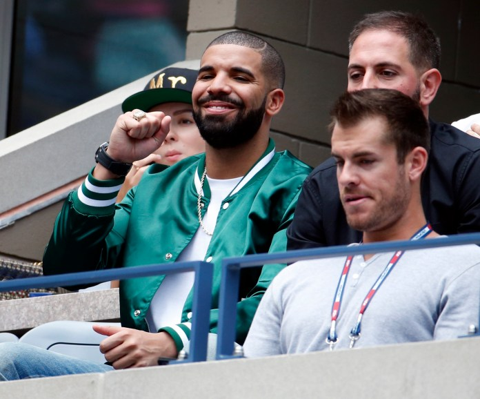 Recording artist Drake, left, cheers during a semifinal match between Roberta Vinci, of Italy, and Serena Williams at the U.S. Open tennis tournament, Friday, Sept. 11, 2015, in New York. (Julio Cortez/AP)