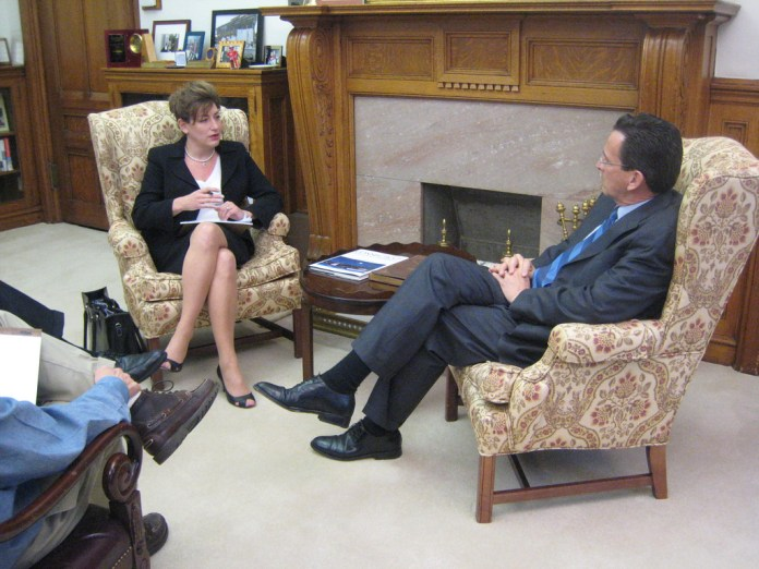 Connecticut Gov. Dan Malloy sits during a meeting with University of Connecticut President Susan Herbst in his office at the State Capitol on Feb. 2, 2011, to discuss UConn's role in the state's economic development. (Office of Governor Dan Malloy/Flickr)