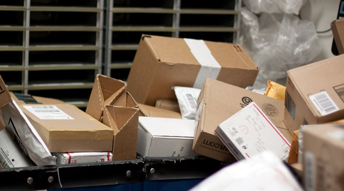 In this photo, packages are pictured in a UConn mail room. The university has received about four times as many packages as usual this fall,university spokesperson Stephanie Reitz said. (Mei Buzzell/The Daily Campus)