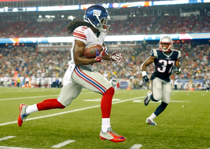 New York Giants wide receiver Geremy Davis runs along the sideline after catching a pass as New England Patriots strong safety Jordan Richards (37) pursues him in the first half of an NFL football gameThursday, Sept. 3, 2015, in Foxborough, Massachusetts.(Winslow Townson/AP)