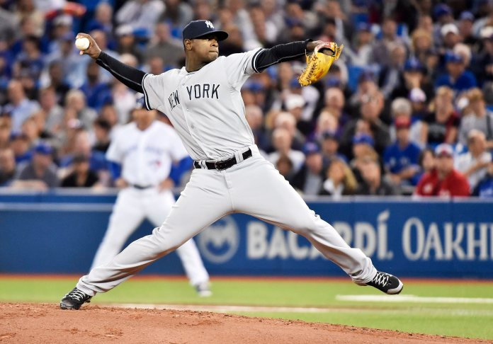 New York Yankees' starting pitcher Luis Severino works against the Toronto Blue Jays during the first inning of a baseball game Tuesday, Sept. 22, 2015, in Toronto. (Nathan Denette/The Canadian Press via AP)