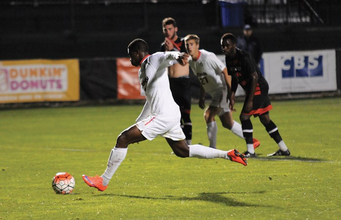 UConn men's soccer freshman forward Abdou Mbacke Thiam takes a penalty during the Huskies' game against Cincinnati at Joseph J. Morrone Stadium in Storrs, Connecticut on Wednesday, Oct. 7, 2015. Thiam scored UConn's lone goal in the 1-1 draw. (Jackson Haigis/The Daily Campus)