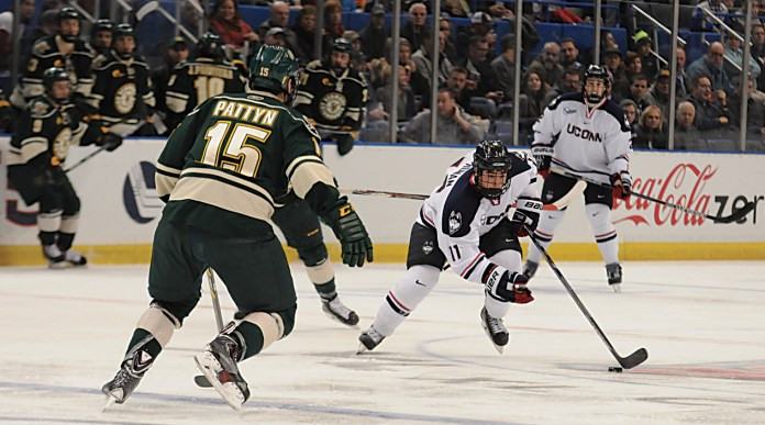 UConn sophomore forward Corey Ronan (11) skates past a Vermont player during the Huskies' game against the Catamounts at XL Center in Hartford, Conn. on Friday, Nov. 21, 2014. (File Photo/The Daily Campus)