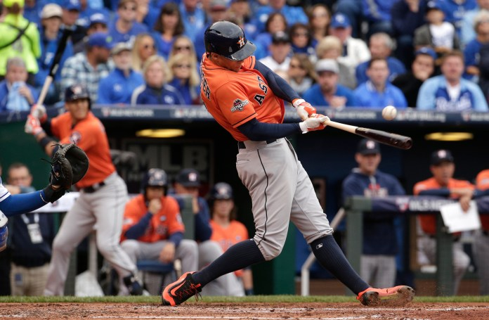 Houston Astros' George Springer hits an RBI-single during the second inning of Game 2 in baseball's American League Division Series against the Kansas City Royals, Friday, Oct. 9, 2015, in Kansas City, Mo. (Charlie Riedel/AP)
