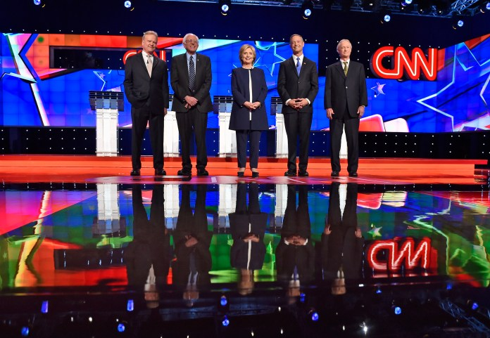 In this Oct. 13, 2015, photo, Democratic presidential candidates from left, former Virginia Sen. Jim Webb, Sen. Bernie Sanders, I-Vt., Hillary Rodham Clinton, former Maryland Gov. Martin O'Malley, and former Rhode Island Gov. Lincoln Chafee take the stage before the CNN Democratic presidential debate in Las Vegas. (David Becker/AP)