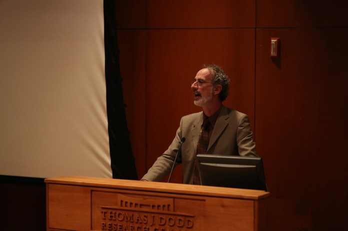 California Pacific Institute President Peter Gleick speaks during his lecture at the Thomas J. Dodd Center in Storrs, Connecticut on Tuesday, Oct. 20, 2015. Gleick discussed the importance of acknowledging the human right to water around the world and outlined the history of how water became a human rights issue.(Jackson Haigis/The Daily Campus)