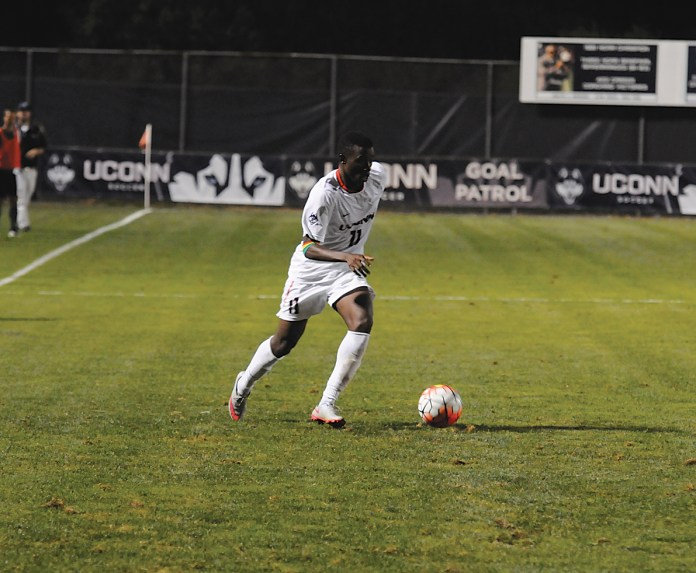 UConn freshman forward Abdou Mbacke Thiam dribbles the ball during the Huskies' game against Dartmouth on Friday, Sept. 4, 2015. Thiam scored a pair of second-half goals to lift UConn to a 2-0 victory on the road Wednesday against Temple. (Amar Batra/The Daily Campus)
