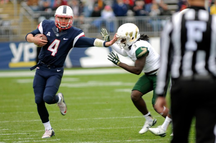 UConn quarterback Bryant Shirreffs scrambles for yards during the Huskies 28-20 loss against USF on October 17th, 2015. Shirreffs finished with 100 rushing yards and a touchdown. (Bailey Wright/The Daily Campus)
