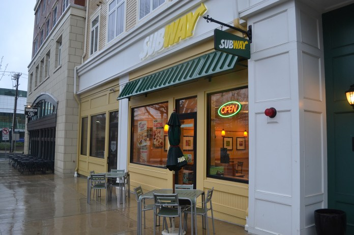 In this file photo, the Subway storefront is seen in Storrs Center.Subway recently announced its plans to no longer offer meat raised with antibiotics. (File Photo/The Daily Campus)