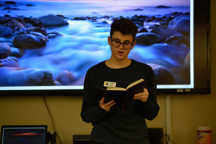 A student reads poetry during a Rainbow Center event in the Student Union on Friday, Oct. 23, 2015.theme was spoken word poetry and it began with a poetry workshop, which transitioned into an open-mic. (Jason Jiang/The Daily Campus)