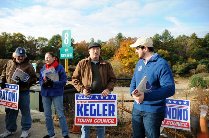 From left to right: Board of education candidate Al Fratoni and town council candidates Virginia Raymond, Steve Kegler and Mark Sargent. Four Mansfield Republican candidates campaigned at the town transfer station Saturday morning, talking with voters about issues ranging from the condition of the town's roads to the amount of money spent in the annual budget. (Amar Batra/The Daily Campus)