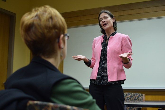 """Barbara Gurr,assistant professor in residence in the Women, Gender and Sexuality Studies department, speaks during """"WGSS, Feminism and the Future: Celebrating New Scholarship"""" at Homer Babbidge Library in Storrs, Connecticut on Monday, Oct. 26, 2015. (Grant Zitomer/The Daily Campus)"""