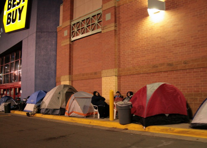 Customers set up camp outside of Best Buy on Thanksgiving night to stake out territory before Black Friday begins at 5 a.m. the following morning. REI has opted out of Black Friday this year, instead urging customers to go outside with their #OptOutside campaign. (David Haines/Flickr)