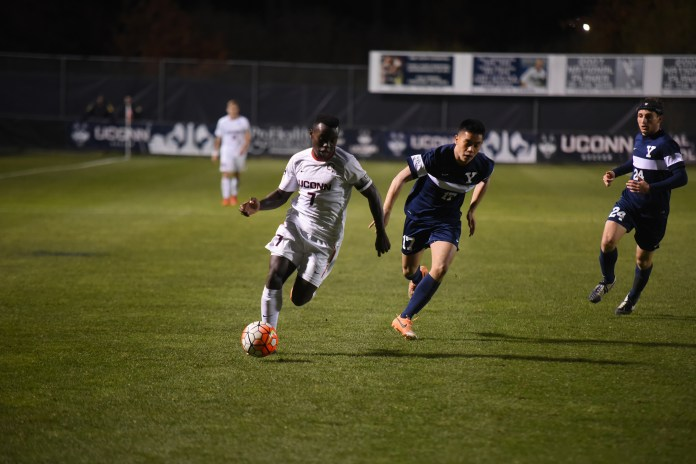 UConn men's soccer midfielder Kwame Awuah dribbles downfield during the Huskies' game against Yale at Joseph J. Morrone Stadium in Storrs, Connecticut on Tuesday, Oct. 27, 2015. Awuah scored UConn's lone goal in the 1-0 victory. (Allen Lang/The Daily Campus)