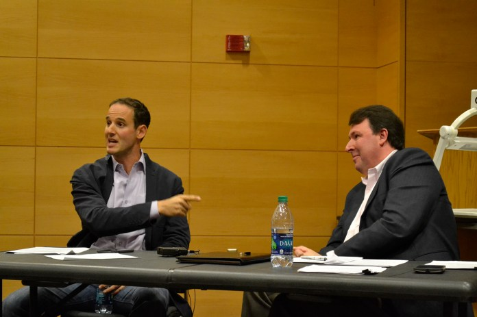 Journalist Jake Halpern (left) speaks next to Marc Thiessen (right), a former speechwriter for President George W. Bush, at a discussion hosted by the UConn College Democrats and College Republicans in the Biophysics Building on Tuesday, Oct. 27, 2015. (Olivia Stenger/The Daily Campus)
