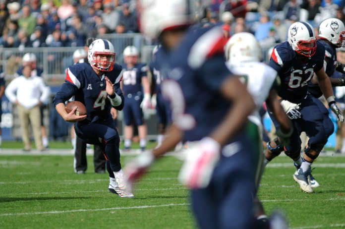 Quarterback Bryant Shirreffs scrambles for yards during UConn's 28-20 loss against USF on Oct.17, 2015. The Huskies will take on East Carolina on Saturday. (Bailey Wright/The Daily Campus)