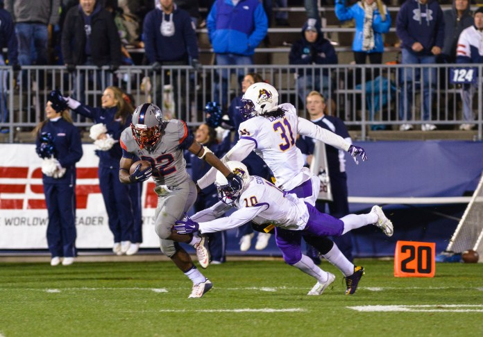 UConn running back Arkeel Newsome breaks a tackle during the Huskies' game against East Carolina at Pratt & Whitney Stadium at Rentschler Field in East Hartford, Connecticut on Friday, Oct. 30, 2015. Newsome finished the game with 179 rushing yards, 244 all-purpose yards and two touchdowns.(Jason Jiang/The Daily Campus)