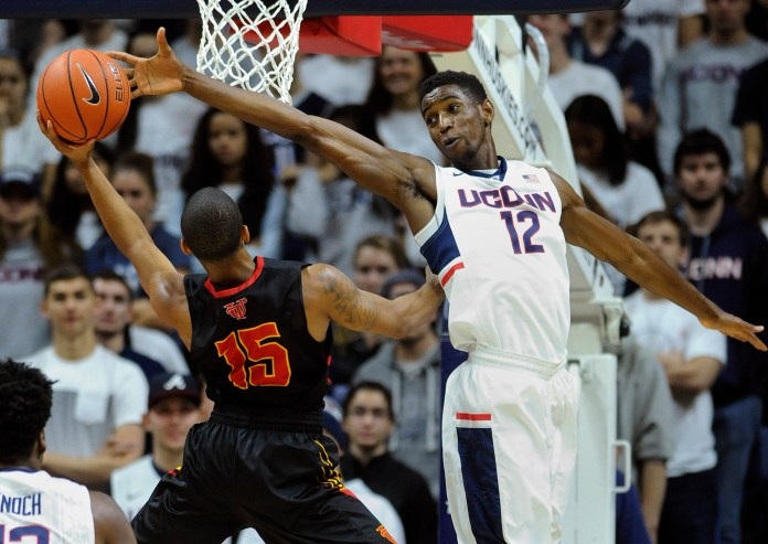 Connecticut's Kentan Facey (12) guards Tampa's Pat Beacon (15) during the second half of an NCAA college basketball game in Storrs, Conn., on Sunday, Nov. 1, 2015. (AP)