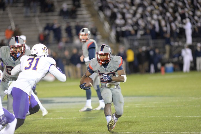 UConn running back Arkeel Newsome runs the ball downfield during the Huskies' game against East Carolina at Pratt & Whitney Stadium at Rentschler Field in East Hartford, Connecticut on Friday, Oct. 30, 2015. Newsome finished the game with 179 rushing yards, 244 all-purpose yards and two touchdowns. (Ashley Maher/The Daily Campus)