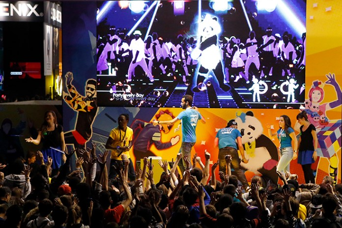 Visitors play Just Dance, a video game published by Ubisoft at the Paris Games Week, a trade fair for video games in Paris, France, Sunday, Nov. 1, 2015. Paris Games week runs from October 28 to November 1, 2015. (AP)