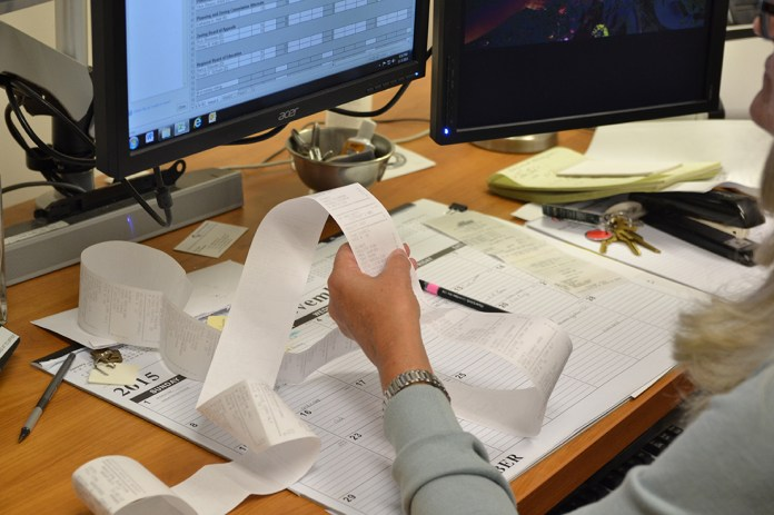 Mansfield Town Clerk Mary Stanton reads out results from various polling stations. Results started to come in at 8:30 p.m., 30 minutes after the polls closed. (Amar Batra/The Daily Campus)
