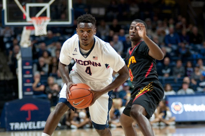 UConn guard Sterling Gibbs surveys the University of Tampa defense during the Huskies' 88-72 win on Nov. 1, 2015. Gibbs, a graduate transfer from Seton Hall, finished with 8 points and 5 assists. (Bailey Wright/The Daily Campus).