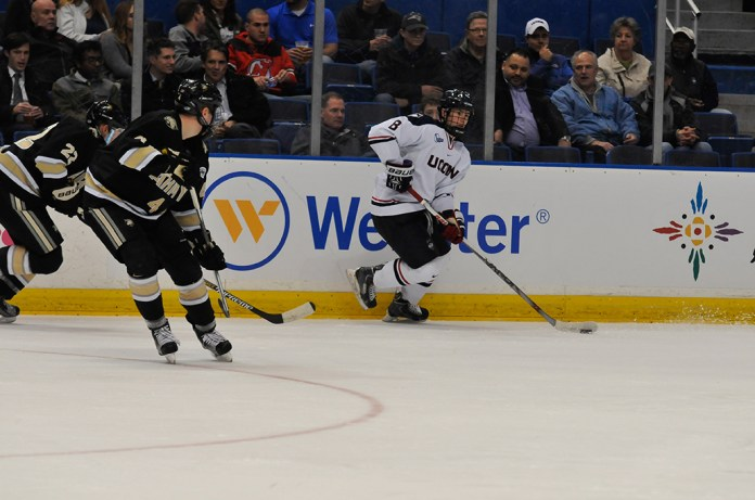 UConn sophomore forward Spencer Naas handles the puck during the Huskies' game against Army at XL Center in Hartford, Connecticut on Tuesday, Nov. 10, 2015. (Amar Batra/The Daily Campus)