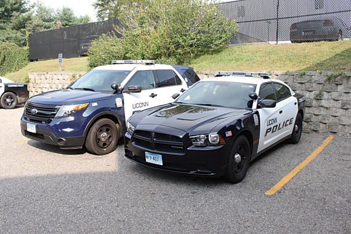 In this file photo, two UConn Police vehicles are pictured. Officer Rachael Levy of the UConn Police Department arrested four men during an attempted break-in at depot campus on Halloween night.(File Photo/The Daily Campus)
