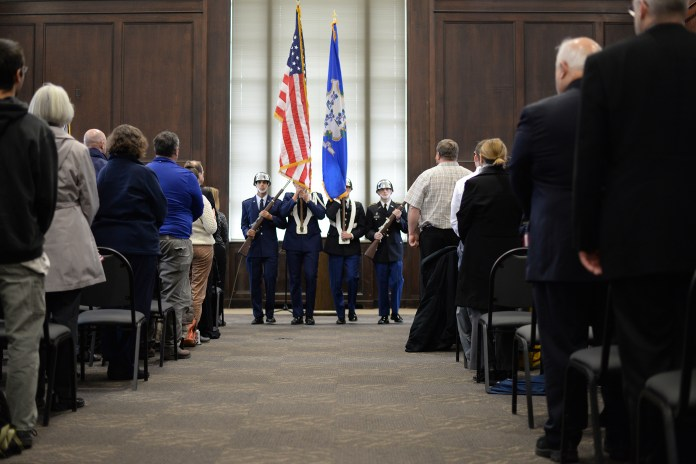 The UConn Army & Air Force ROTC Joint Cadet Color Guard performs the presentation of the colors to commence UConn's Veteran's Day ceremony in the Wilbur Cross North Reading Room in Storrs, Connecticut on Wednesday, Nov. 11, 2015. (Ashley Maher/The Daily Campus)