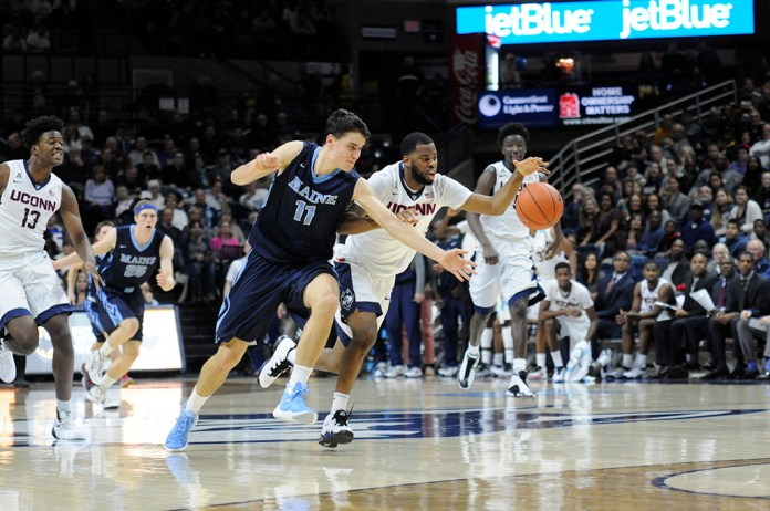 Sam Casselll Jr. (#10) forces a turnover during UConn's 100-56 victory over Maine on Nov. 13, 2015 at Gampel Pavilion. Cassell Jr. finished with two steals. (Bailey Wright/The Daily Campus).