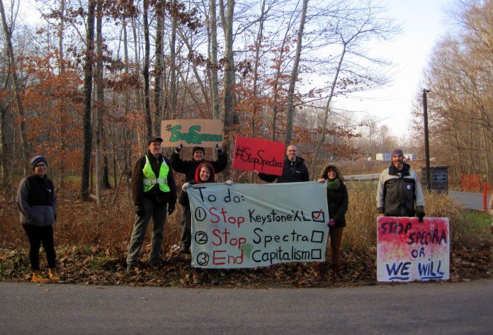 Members of Capitalism vs. the Climate and 350 Connecticut, regional advocacy groups focused on advancing renewable energy, are seen protesting at the Algonquin Gas Transmission Company site on Tower Hill Road in Chaplin, Connecticut on Monday, Nov. 15, 2015. (Courtesy/Katherine Gregory)