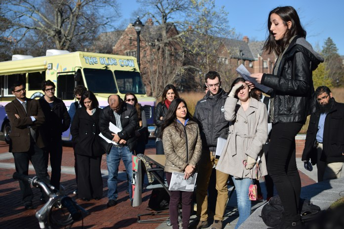 """A student is seen speaking during """"'Speak Out'on the Syria Refugee Emergency"""" between Homer Babbidge Library and the Rowe Center for Undergraduate Education in Storrs, Connecticut on Monday, Nov. 16, 2015. (Grant Zitomer/The Daily Campus)"""