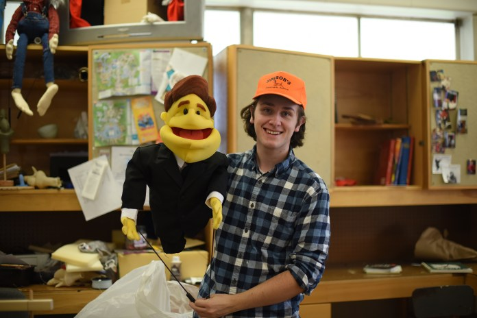 """In this photo, fifth-semester puppet arts major John Cody is pictured.""""Puppetry tricks you into seeing something you're not,"""" Cody said. """"You're not actually seeing a living, breathing thing... It's all one big trick, but it's fun, and it takes a lot of effort."""" (Allen Lang/The Daily Campus)"""