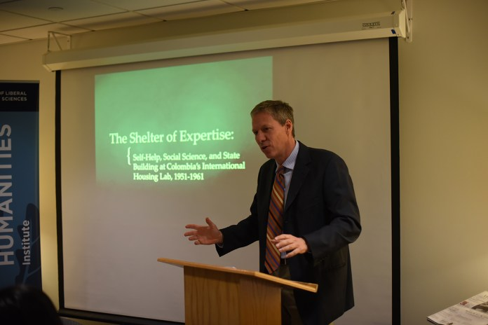 Mark Healey, assistant professor of history at the University of California, Berkley, presented on the large population shift from rural villages to urban centers in Colombia and how the country has modernized (Zhelun Lang/Daily Campus)