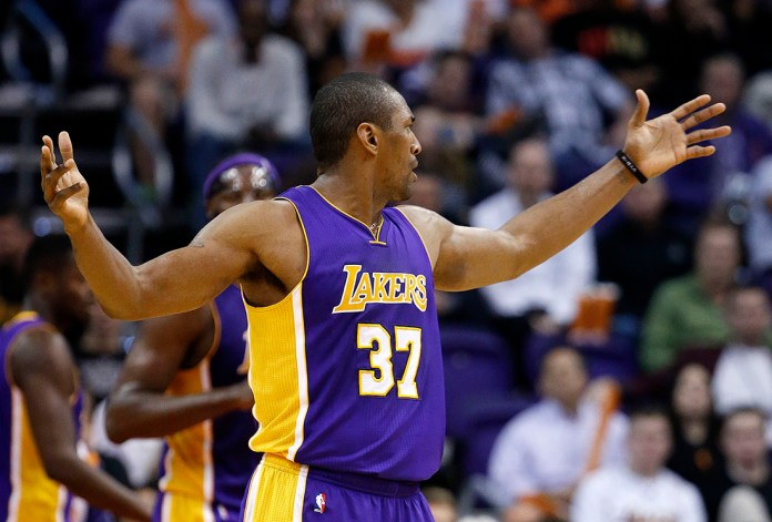 Los Angeles Lakers' Metta  World  Peace raises his arms during the second half of an NBA basketball game against the Phoenix Suns, Monday, Nov. 16, 2015, in Phoenix. The Suns defeated the Lakers 120-101. (AP