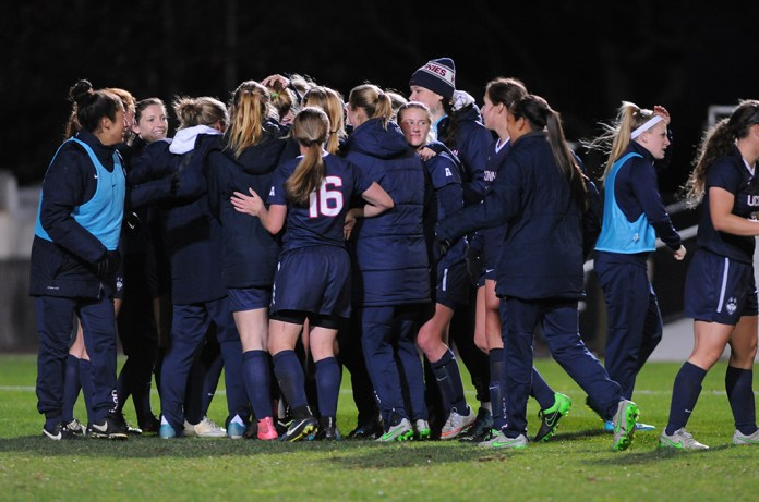 The UConn women's soccer team celebrates after upsetting No. 10 Notre Dame 2-0 in Piscataway, New Jersey on Friday, Nov. 20, 2015. Junior forward Rachel Hill scored both goals. (Amar Batra/The Daily Campus)