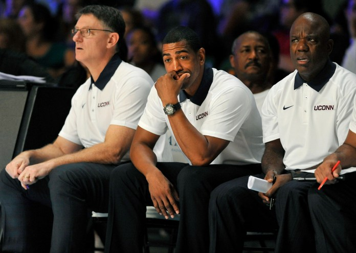Connecticut head coach Kevin Ollie, center, looks on as his team plays Gonzaga during the second half of an NCAA college basketball game, Friday, Nov. 27, 2015 in Paradise Island, Bahamas. (Brad Horrigan/Hartford Courant via AP)