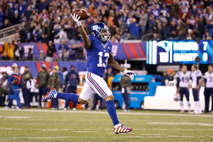 New York Giants wide receiver Odell  Beckham (13) celebrates as he runs for a touchdown during the first half of an NFL football game against the New England Patriots, Sunday, Nov. 15, 2015, in East Rutherford, N.J. (AP)