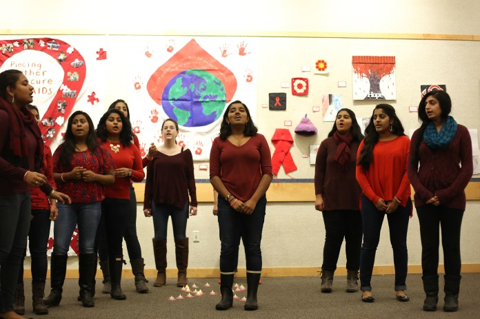 Students are seen at the 'Art4AIDS' art gallery opening in the UConn Student Union on Wednesday, Dec. 2, 2015. The opening was the third of multiple HIV/AIDS-related events hosted in honor of World AIDS Week, which began with World AIDS Day on Dec. 1. (Jackson Haigis/The Daily Campus)