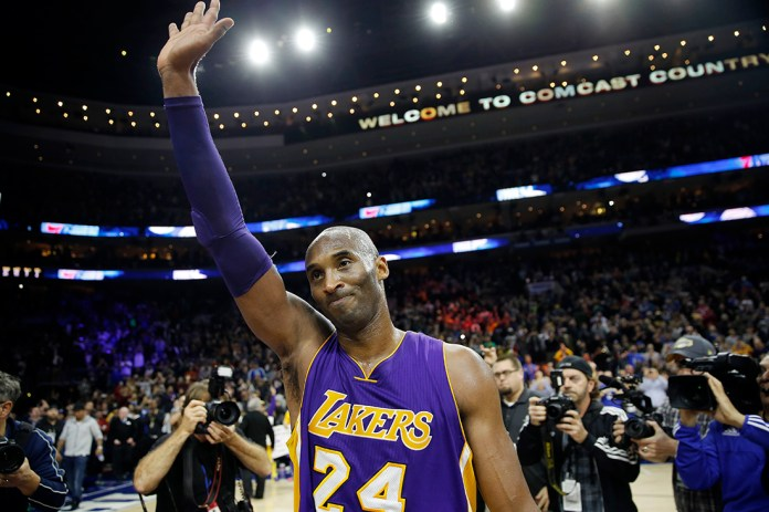 Los Angeles Lakers' Kobe Bryant waves to the crowd after an NBA basketball game against the Philadelphia 76ers, Tuesday, Dec. 1, 2015, in Philadelphia. Philadelphia won 103-91. (AP).