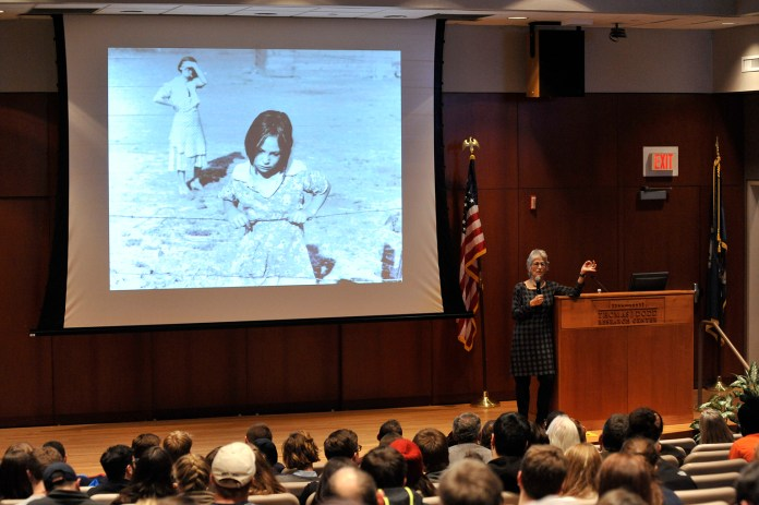Professor Linda Gordon from New York University give a speech about the life and photography of Dorothea Lange. (Jason Jiang/The Daily Campus)