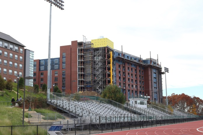 In this photo, the new STEM dorm is seen under construction behind the Sherman Family Sports Complex in Storrs, Connecticut on Monday, Nov. 2, 2015. (Jackson Haigis/The Daily Campus)