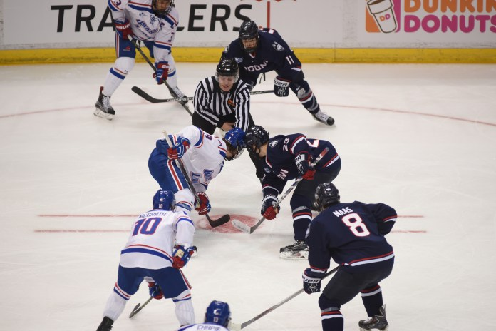 UConn sophomore forward Kasperi Ojantakanen (23)prepares to take a faceoff during the Huskies' game against UMass-Lowell at the XL Center in Hartford, Connecticut on Saturday, Dec. 5, 2015. (Zhelun Lang/The Daily Campus)