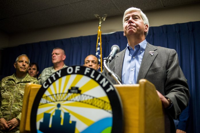 Gov. Rick Snyder speaks about the Flint water crisis during a press conference at City Hall in downtown,Flint, Mich. Environmental and civil rights groups want a federal judge to order the prompt replacement of all lead pipes in Flint's water system to ensure that residents have a safe drinking supply, a demand that Snyder said might be a long-term option but not an immediate one. (The FlintJournal-MLive.com via AP)