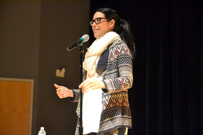 Spoken word poet Katie Wirsing speaks at a spoken word poetry event in the Student Union Theater on Thursday, Jan. 28, 2016.Wirsing, a former member of the 2006 National Poetry Slam Championship team, has had her work featured on NPR and the BBC. (Olivia Stenger/The Daily Campus)