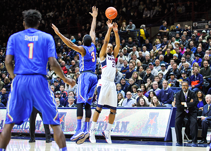 Omar Calhoun rises for a three pointer during UConn's 75-73 win over Tulsa. He finished with 14 points. (Jason Jiang/The Daily Campus)