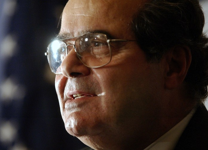 In this Saturday, Oct. 8, 2005 file photo, U.S. Supreme Court Justice Antonin Scalia speaks during a news conference in New York. On Saturday, Feb. 13, 2016, the U.S. Marshals Service confirmed that Scalia has died at the age of 79. (AP Photo/Chad Rachman)