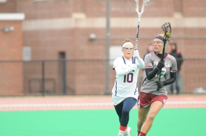 In this file photo from April 8, 2015, game against Temple University,sophomore Grace Nolan takes on an opponent. Nolan picked up where she left off last season as Rookie of the Year with seven goals against the Quinnipiac Bobcats.